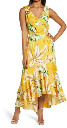 This sweet, summery maxi wrap dress is styled in a sleeveless silhouette with bow-topped shoulders and a layered ruffle skirt.