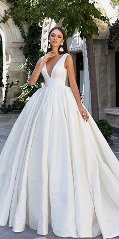 White wedding dress. Brides imagine finding the perfect wedding ceremony, but for this they require the most perfect wedding gown, with the bridesmaid's dresses actually complimenting the brides dress. The following are a variety of ideas on wedding dresses.