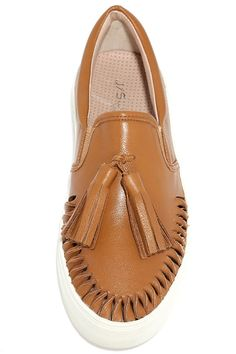 "Upgrade to the J Slides Aztec Tan Leather Slip-On Sneakers and be the envy of all of your friends! Twisted cutouts and tassels decorate the smooth leather upper of these slip-on sneakers. 1.25"" white bumper sole."