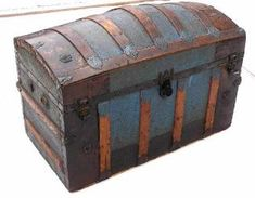 A beautiful dome top trunk with casted locks, and a beautiful geometric tin pattern, great ornamentation