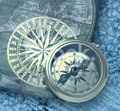 nautical: Book with retro golden compass on it Stock Photo Royalty Free Images, Royalty Free Stock Photos, The Golden Compass, Lifebuoy, Stock Pictures, Nautical, Steering Wheels, Retro, Gauges