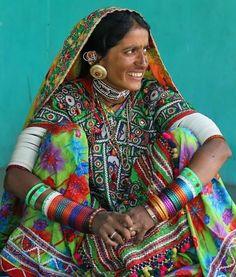 JOJO POST FASHION: Gujarati Woman (India) she is wearing beautiful textiles and arms full of bangles Insane Cyberpunk Hair, futuristic fashion, cyber fashion, futuristic look, Pants, Shoes, Hat, Cuff, Bracelet, futuristic boy, Girl, Woman, Man, cyberpunk, cyber punk, cyber hair, future fashion. Steam.
