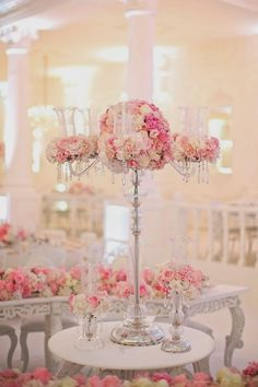 Photographer: Pauline & Jacob; Glamorous pink and white floral wedding reception centerpiece with silver stem;