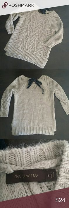 """🍁GORGEOUS LIMITED SWEATER🍁 🍁Oatmeal colored cable knit sweater 🍁Has navy blue velvet tie on back 🍁3/4 sleeves 🍁Slits on each side 🍁Slight hi-lo hem  🍁90% acrylic 10% wool 🍁No rips, stains, pulls or pills 🍁Woven fabric fuzzy by design 🍁16.5"""" armpit to armpit, 21"""" from center of collar to bottom of front 🍁Smoke free home The Limited Sweaters"""