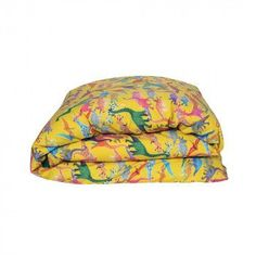 Dinosaur print duvet cover in sulphur yellow, with green cotton on reverse.