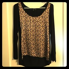 Black and bronze dress top EUC! Black and bronze long sleeve dress top. Front is 100% polyester piece with bronze and black Aztec design and sleeves and back are rayon/spandex mix. Slight high-low style as shown in photos. Size medium. Open to offers! Have Tops Tees - Long Sleeve