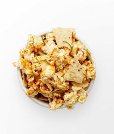 Mix 2 tablespoons olive oil, 1 Tbsp. each chili powder and grated lime peel, 1/2 teaspoon cumin, and 1/4 teaspoon garlic powder; toss with 1 bag microwave popcorn, popped, and 1 cup tortilla chip pieces. Serves 8