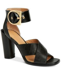 Calvin Klein Women's Alivia Ankle-Strap Sandals $111.00 Pairing an oversized gold-tone buckle and chunky ankle strap, Calvin Klein's Alivia sandals dress up any ensemble with eye-catching modern savvy.