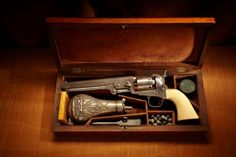 COLT M1851 REVOLVER: General Lee once owned a very similar engraved revolver with ivory grip panels in 1865.