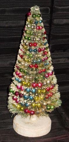 Vintage bottle brush tree with mercury glass beads.