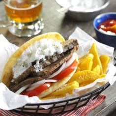 Favorite Meat Loaf Gyros gyros is a Greek dish of meat roasted on a vertical spit. It is usually served in a pita bread with tomato, onion, and tzatziki sauce.