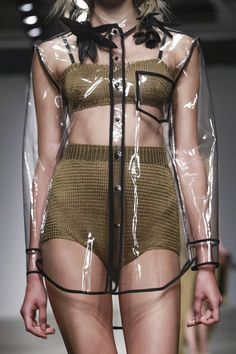 Transparency: knitted two-piece + clear plastic shirt with black trim; see-through fashion details // Osklen SS15