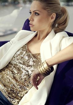 Creme blazer and gold sequin shirt.