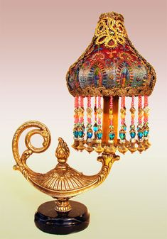 Enchanting little vintage genie lamp from Europe is topped with a hand beaded Sheik shaped shade.