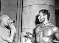 Yul Brynner takes a picture of Charlton Heston during filming of The Ten Commandments