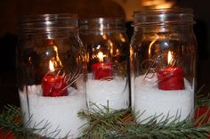 epsom salt, candles and mason jars - simple and beautiful. The salt also makes it easy to clean up the wax. Sand works well too.