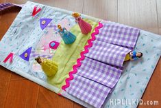 Princess Castle Play Mat - Playmat perfect for the kid on the go. Purse folds out to a playmat and has 4 pockets for your princesses or dolls.  $45 CAD  Hip Lil' Kid