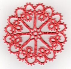 The tatted wheel is one of a number of basic tatting motifs, tatted with shuttle only. This motif is common in the early tatting books/bookl...