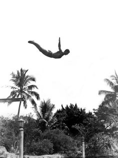 1940s Man Poised Midair Arms Out Jumping from Diving Board into Pool Photographic Print at AllPosters.com