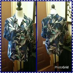 Blue button up blouse. Beautiful short sleeve button up top. With exotic leaf pattern in colors of white, turquoise and purple. Two front pockets.  Rolled sleeves.  New with tag. Croft & Barrow Tops Blouses