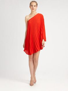 Wearing a pleated skirt off one shoulder does not make the skirt a dress. $395
