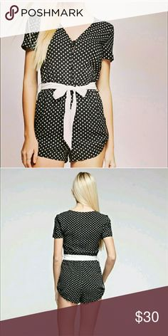 """Polkadot romper Black and white romper. Fully lined shorts, button front and buttons on shorts to add extra length if u want. Size small, medium and large available.  Adorable like this or layered for cool weather with tights and cardigan.   Small measures 30"""" length 3.75 inseam 11"""" waist and elastic 16.5"""" waist   Price firm No trades  Comment on size preferred Tea n Cup Pants Jumpsuits & Rompers"""