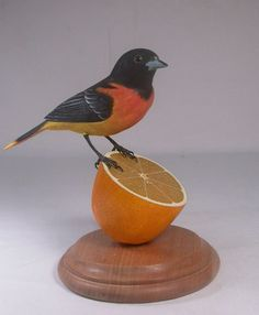 Baltimore Oriole Wooden carved Bird. $195.00, via Etsy.
