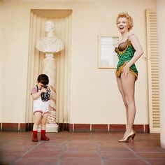 Marilyn Monroe with Milton Greene's son