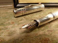 a silver fountain pen