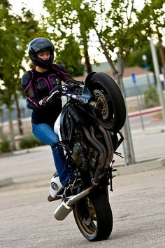 Here's a nice shot of the ever-amazing Leah Stunts (Petersen) poppin' a wheelie, my last post for today since I overloaded you with text-images.