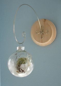 nature inspired miniature winter scene ornament.