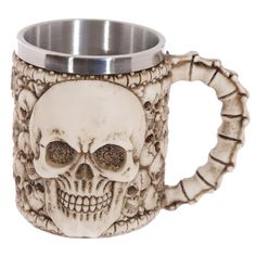 #skull #gruesome PRICE £11.49 Gruesome Skulls Tankard with Spine Handle, made from resin and with a stainless steel liner. Dimensions: Height 10.5cm Width 14cm Depth 10cm We have more tankards and goblets in our online shop!
