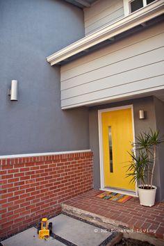 yellow door, grey with red brick