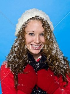 portrait of a cheerful young woman in winter clothing. - Portrait of a cheerful young woman in winter clothing against turquoise background, Model: Brittany Beaudoin