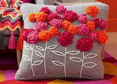 Pillow is embellished with embroidery and Flower Pillow: Crochet Roses