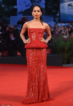 Lady in red: Her co-star, Zoe Kravitz, chose to stand out in a much more eye-catching styl...