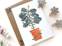 Is there a fiddle-leaf fig tree lover on your holiday gift list? Some clues: This person fusses happily over houseplants, takes endless photos of a favorite potted tree, and may even use tags such as … Easy Care Indoor Plants, Charlie Brown Christmas Tree, Vintage Christmas Lights, Fiddle Leaf Fig Tree, Christmas Wrapping, Holiday Cards, Gift Guide, Hand Lettering, Gifts