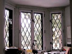 This leaded lattice bay window will give your home an authentic cottage feel.
