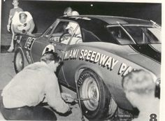 vintage racing changing a tire the old fashioned way without an air wrench. Do you remember those days?