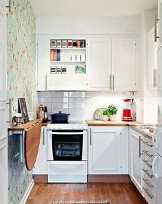 space-saving-ideas-small-kitchens-storage-solutions (5) fold up table or counter is genius!