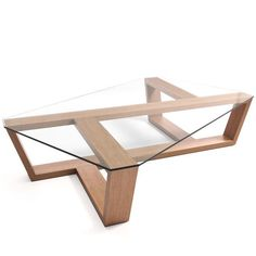 The sculptural Agol Table is made from solid oak in a choice of finishes and topped with a solid piece of glass. This table will be a focal point in any living area and give an atmosphere of light and airiness.