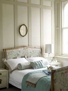 the word pretty is perfect for this bedroom.  the soft 2 tone wall color, the beautiful fabric covered bed, the bedding, all make for the word pretty.