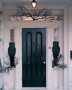 A pair of wide-eyed owls guard the front door. To make their perches, you need only a few bare branches from a crafts store or your own yard. Paint the branches black and wedge them into place.Print the Owl Template