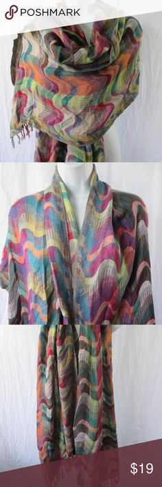 Colorful Boho Hippie Festival Scarf or Wrap Absolutely Stunning Scarf from Quagga Accessories  Purple, green, orange and blue shades  Wonderful wavy design mimics sensuous, flowing movement  100% viscose rayon  Length 72 plus 3 inches fringe  Width 28 Accessories Scarves & Wraps