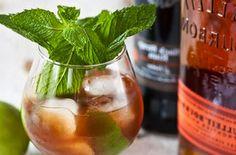 Admiral Schley's Punch: 1 oz. dark rum 1 oz. bourbon 1 lime 1 tsp. sugar Mint sprig Pineapple wedge (optional)
