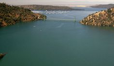 The Green Bridge passes over full water levels near Bidwell Marina on July 20, 2011, in Oroville, California, and much lower levels on Aug. 19, 2014.