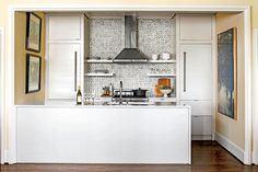 Keep Cabinetry Streamlined - 50 Best Small Space Decorating Tricks We Learned in 2016 - Southernliving. Hide clutter with streamlined, minimalist-inspired cabinetry. This small kitchen maintains visual consistency by mirroring the style of the cabinets and bar. The glossy white hue keeps things light and airy too. A bar or island is also a great place to incorporate seamless storage—if you can, add drawers for all your tools and a place for a trash can. An island with storage keeps…