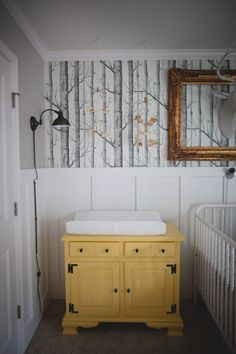 woodland nursery love the wall paper