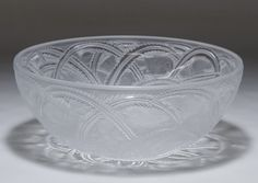 "Lot 349: Lalique Crystal Pinson Bird Bowl; Having a ""Lalique France"" signature on the underside and a bird pattern in swirl form on the bowl"