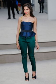 London Fashion Week: Freida Pinto looked stunning at the Burberry Prorsum fall 2013 fashion show during the London Fashion Week. The Slumdog Millionaire, who wore a a Burberry ensemble, looked gorgeous in a royal blue satin bustier peplum top, fitted pants and peep-toe suede heels.